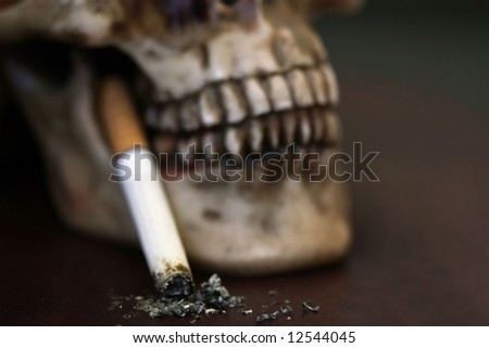 Skull with Burnt Cigarette