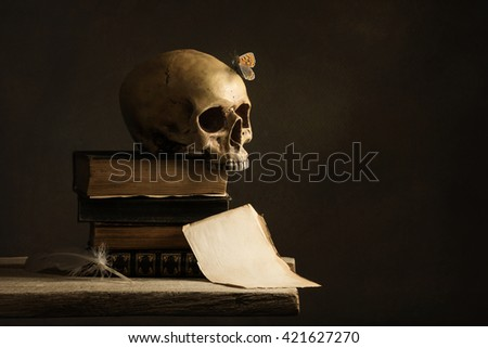 Skull with Butterfly and a empty Page with Feather - stock photo
