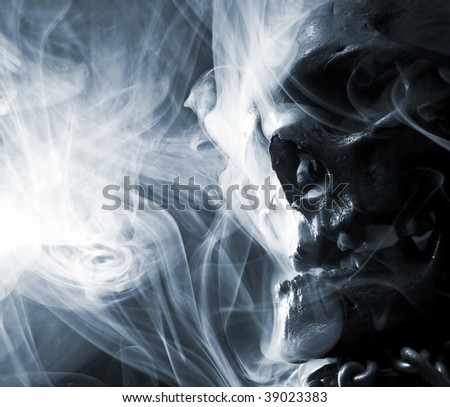 skull with chain in abstract smoke - stock photo