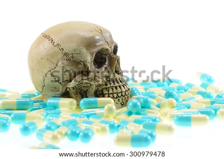 skull with pills on white background - stock photo