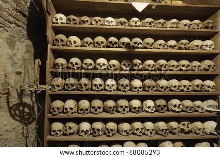 skulls of the monks in Meteora monastery - stock photo