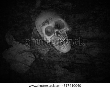 Skulls, skeletons on the scrap heap of rotting leaves. Spooky, scary, Monochrome Black and White, stain, crust, speck, smear, smirch, grunge - stock photo