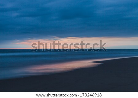 Sky after sunset seen from the beach - stock photo
