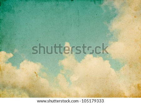 Sky and billowing clouds on a textured vintage paper background with grunge stains and retro colors.