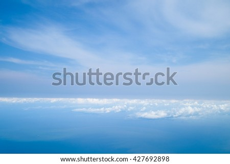 Sky and cloud as seen through window of an aircraft - stock photo