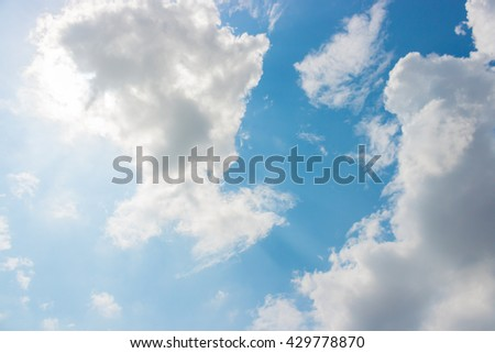 Sky and clouds against the sunlight. For abstract background or insert text copy space. - stock photo