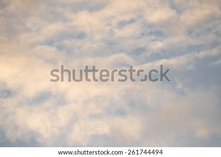 Sky and clouds background taken at sunset - stock photo