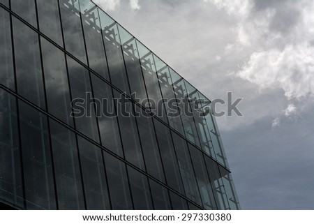 Sky and Storm Cloud Reflection  on Contemporary Architecture  - stock photo