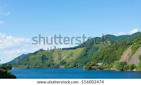 sky and the lake and mountains - stock photo