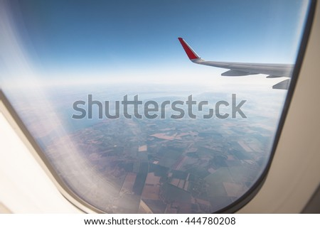 sky as seen through window of an aircraft - stock photo