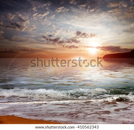 sky at sunset and sandy Mediterranean coast