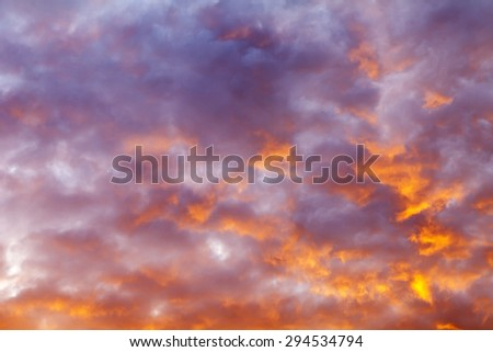 Sky at sunset. The clouds which are picturesquely lit with the setting sun