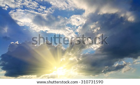 Sky background with dark clouds and bright sunlight - stock photo
