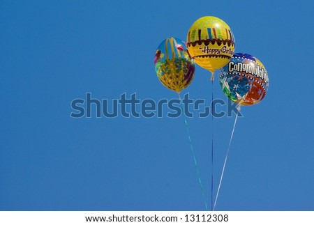Sky balloons against blue - stock photo