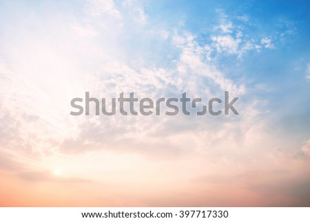 Sky blue and orange light of the sun through the clouds in the sky survive. - stock photo