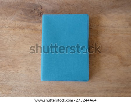 Sky blue leather notebook on wooden table, the personal organize - stock photo