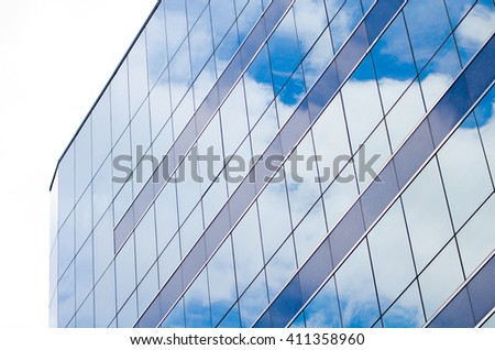 Sky Building, Modern glass of skyscrapers in the city. A mirrored buildin. Office Building and sky. Building during Daytime - stock photo