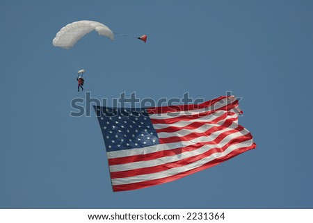 Sky diver with large American flag. - stock photo