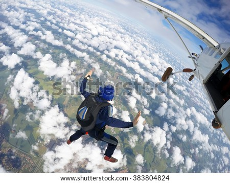 Sky diving from the airship - stock photo