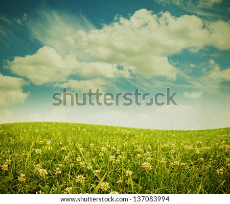 Sky field landscape on a textured vintage paper background - stock photo