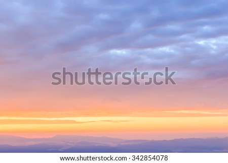 Sky gradient from blue to orange sunset  - stock photo