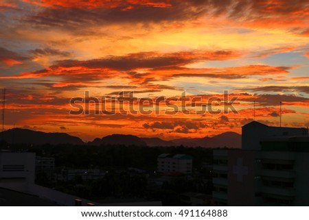 sky in sunset and motion cloud beautiful colorful evening nature  landscape    twilight  time  with city silhouette