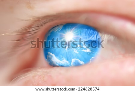 Sky into the eye. Conceptual design. Shallow depth-of-field. - stock photo