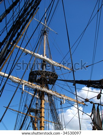 Sky. Mast ship. A lot of rope.