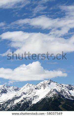 sky over italian Alps, over Aprica Pass. Sondrio province, Lombardy region. Slopes along the mountain. - stock photo