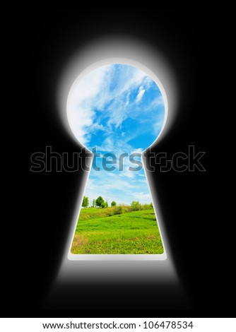 Sky over the meadow in keyhole isolated on black background - stock photo