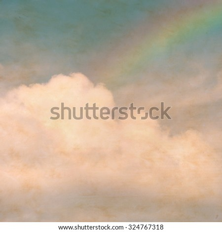 Sky rainbow clouds on a textured, vintage paper background with grunge stains. - stock photo