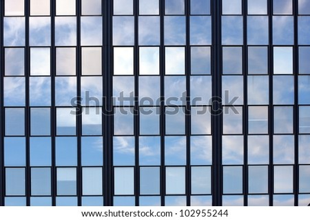 Sky reflection in mirror windows - stock photo