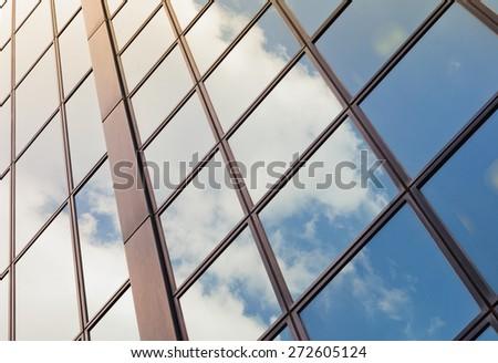 Sky reflection on glass modern building - stock photo