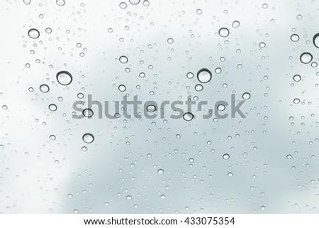 sky view through car window with rain drops, Driving in rain. - stock photo