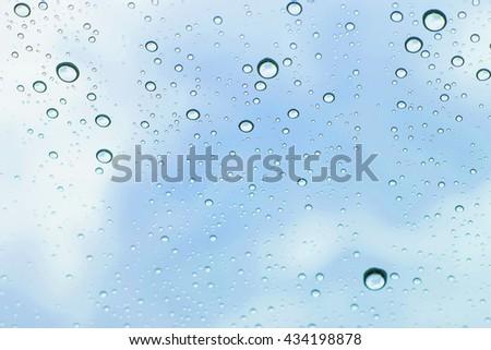 sky view through car window with rain drops, Driving in rain - stock photo