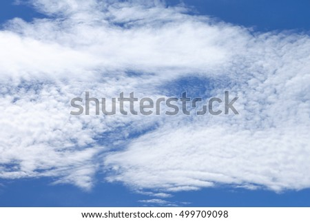 Sky view with white clouds in the middle of summer.