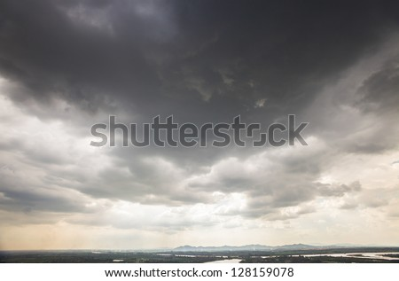 sky with black clouds before a summer rainstorm - stock photo
