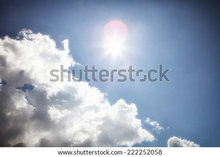 Sky with cloud and sun flare - stock photo