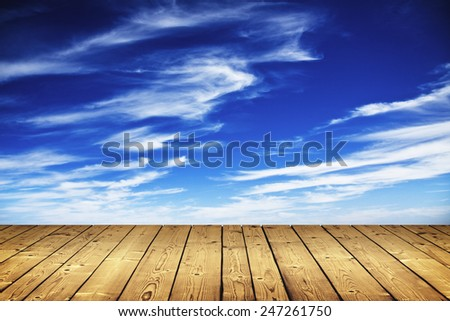 sky with clouds and wood floor - stock photo