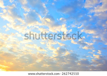 Sky with clouds at sundown, may be used as background - stock photo