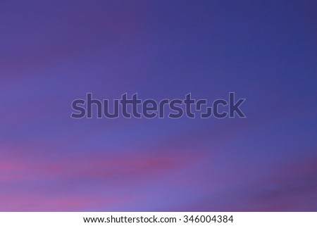 Sky with clouds in blue and pink purple sunset evening pastel colors photo. - stock photo