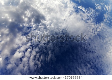 Sky with clouds in windy day. Wide-angle view. - stock photo