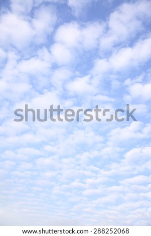 Sky with clouds, may be used as background (vertical) - stock photo