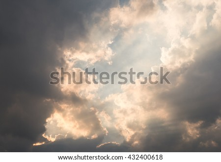 Sky with dark clouds and sun rays - Red sunset, rich dark clouds, rays of light - stock photo