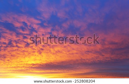 Sky with dramatic cloudy sunrise - stock photo