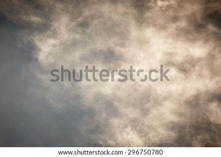 Sky with grey stormy clouds. Nature background - stock photo
