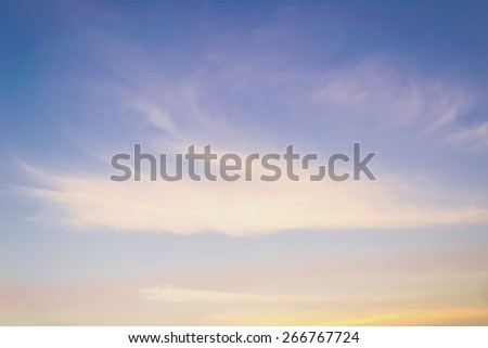 Sky with soft clouds on wind movement at sunset: Blurred natural background bright blue windy sky; Backdrop for holiday sunny vacation seasonal decoration artworks, craft, arts antique style   - stock photo