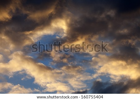 Sky with storm clouds at sunset - stock photo