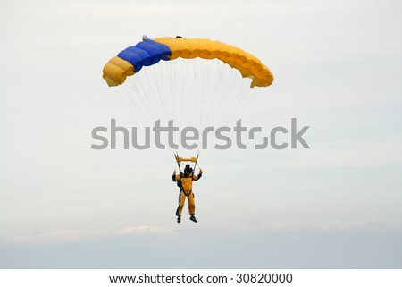 Skydiver coming into land - stock photo