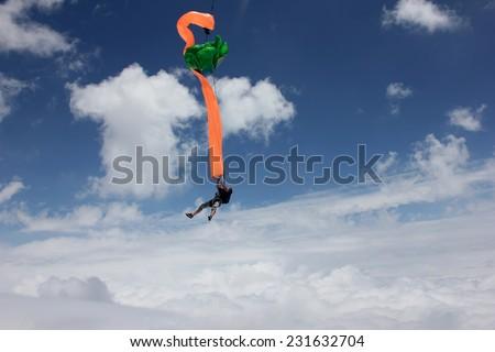Skydiver deploys his parachute - stock photo